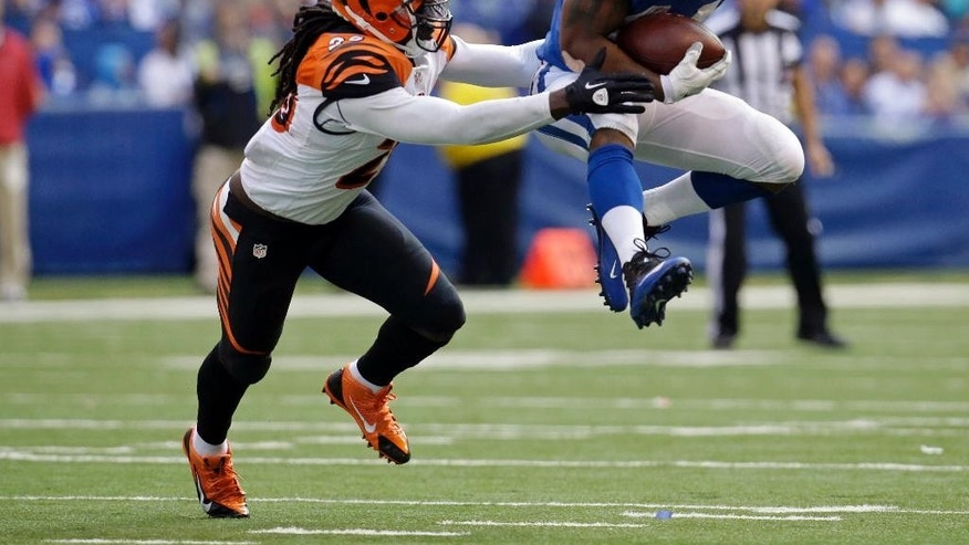 Indianapolis Colts running back Ahmad Bradshaw (44) is tackled by Cincinnati Bengals free safety Reggie Nelson (20) during the second half of an NFL football game, Sunday, Oct. 19, 2014, in Indianapolis. (AP Photo/AJ Mast)