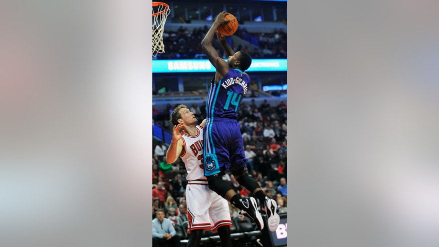 Charlotte Hornets' Michael Kidd-Gilchrist (14), goes up for a shot against Chicago Bulls' Mike Dunleavy (34), during the first half of an NBA basketball game in Chicago, Sunday, Oct. 19, 2014.  (AP Photo/Paul Beaty)