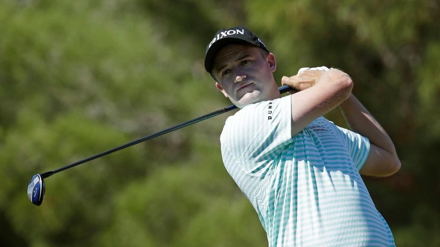 Russell Knox hits off the first tee during the final round of the Shriners Hospitals for Children Open golf tournament Sunday, Oct. 19, 2014, in Las Vegas. (AP Photo/John Locher)