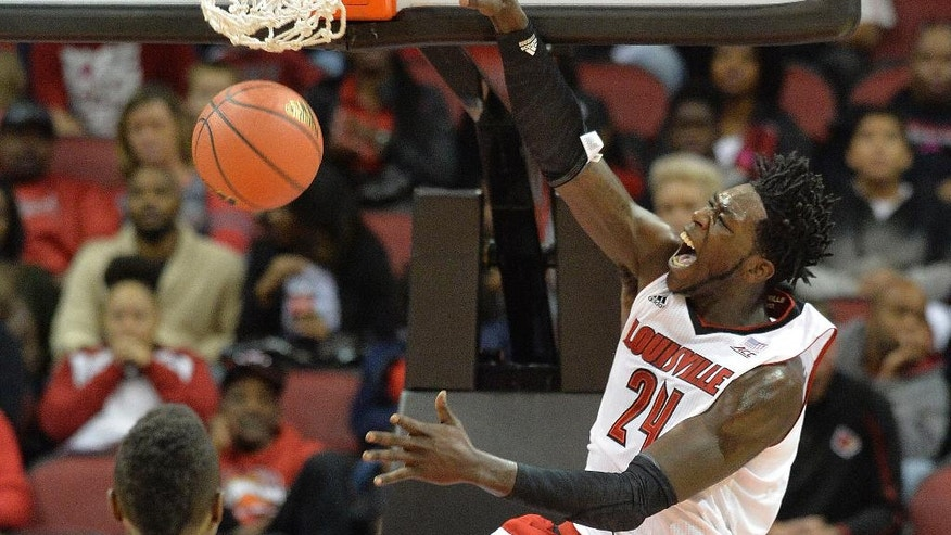 Louisville's Montrezl Harrell, right, dunks as Louisville's Chinanu Onuaku looks on during the first half of an NCAA college basketball scrimmage Sunday, Oct. 19, 2014, in Louisville, Ky. (AP Photo/Timothy D. Easley)