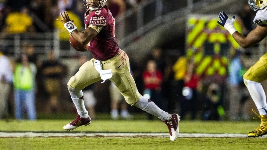 Florida State quarterback Jameis Winston scrambles in the first half of an NCAA college football game against Notre Dame in Tallahassee, Fla., Saturday, Oct. 18, 2014. (AP Photo/Mark Wallheiser)