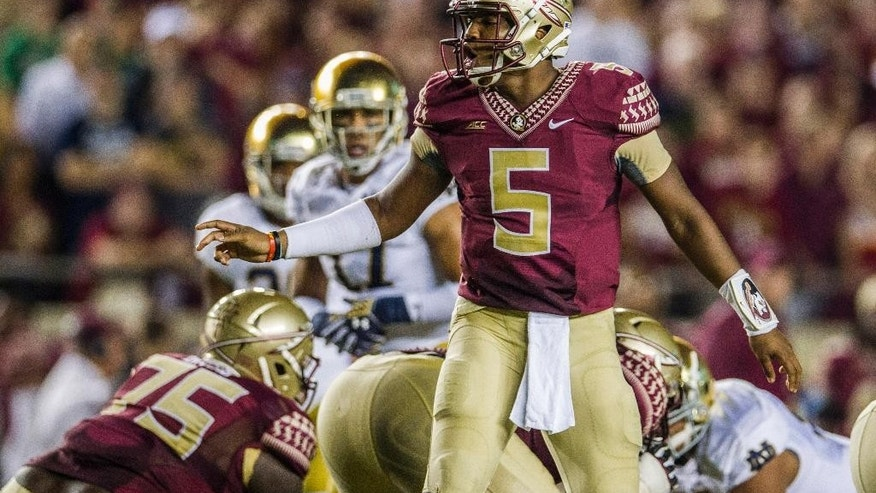 Florida State quarterback Jameis Winston changes the play at the line of scrimmage in the first half of an NCAA college football game against Notre Dame in Tallahassee, Fla., Saturday, Oct. 18, 2014. AP Photo/Mark Wallheiser)