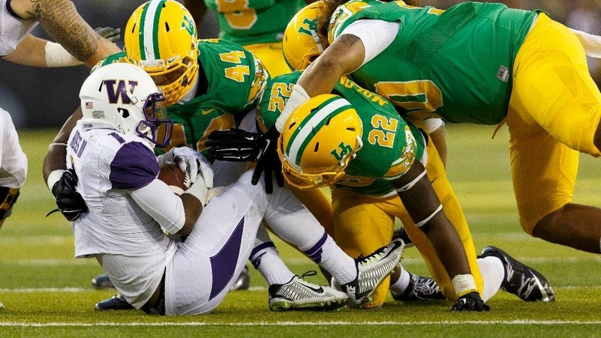 Washington wide receiver John Ross (1) is shoved to the ground by Oregon defenders during the second quarter of an NCAA college football game in Eugene, Ore., Saturday, Oct. 18, 2014. (AP Photo/Ryan Kang)