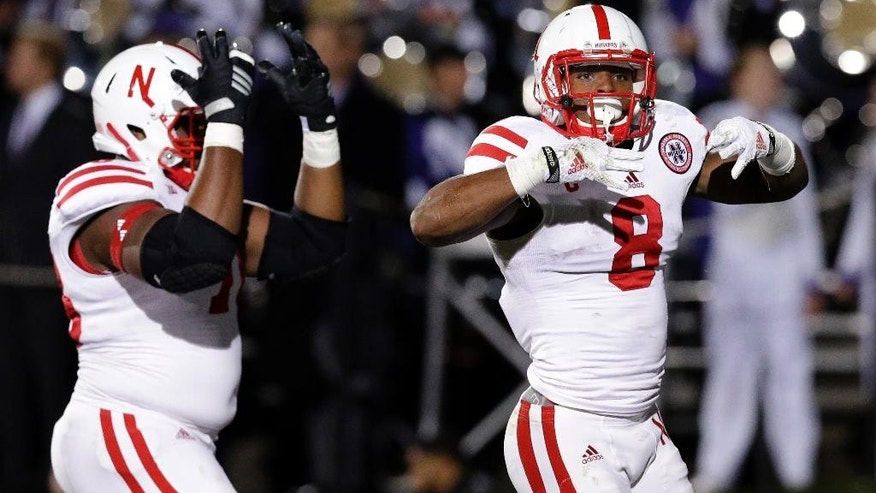 Nebraska running back Ameer Abdullah (8) and offensive line Givens Price (78) celebrate after Abdullah scored a touchdown during the first half of an NCAA college football game against Northwestern in Evanston, Ill., Saturday, Oct. 18, 2014. (AP Photo/Nam Y. Huh)