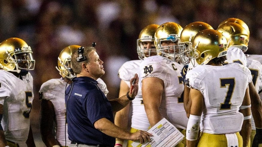 Notre Dame coach Brian Kelly talks to his team late in the second half of an NCAA college football game against Florida State in Tallahassee, Fla., Saturday, Oct. 18, 2014. Florida State won 31-27. (AP Photo/Mark Wallheiser)