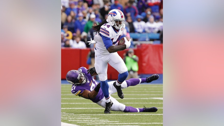 Buffalo Bills wide receiver Sammy Watkins (14) breaks a tackle by Minnesota Vikings' Josh Robinson (21) during the first half of an NFL football game Sunday, Oct. 19, 2014, in Orchard Park, N.Y. (AP Photo/Bill Wippert)