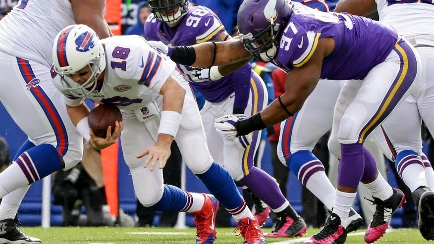 Minnesota Vikings defensive end Everson Griffen (97) sacks Buffalo Bills quarterback Kyle Orton (18) during the second half of an NFL football game, Sunday, Oct. 19, 2014, in Orchard Park, N.Y. (AP Photo/Bill Wippert)