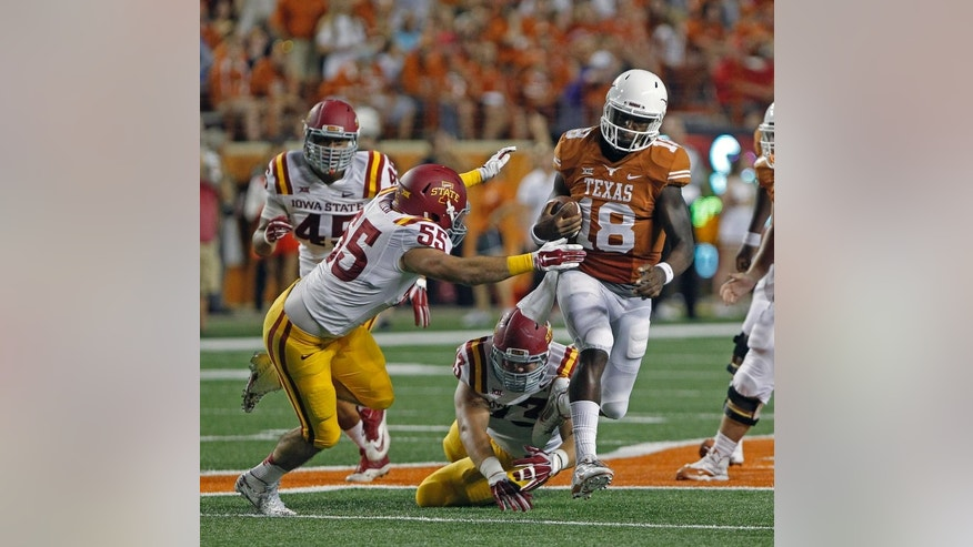 Texas quarterback Tyrone Swoopes (18) runs the ball against Iowa State linebacker Jevohn Miller (55) and lineman Tom Farniok (74) during the first quarter of an NCAA college football game against Iowa State in Austin, Texas, Saturday, Oct. 18, 2014. (AP Photo/Michael Thomas)