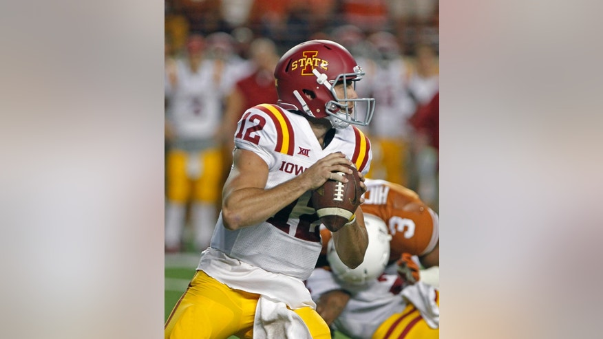 Iowa State quarterback Sam Richardson (12) looks to pass during the first quarter of an NCAA college football game against Texas in Austin, Texas, Saturday, Oct. 18, 2014. (AP Photo/Michael Thomas)