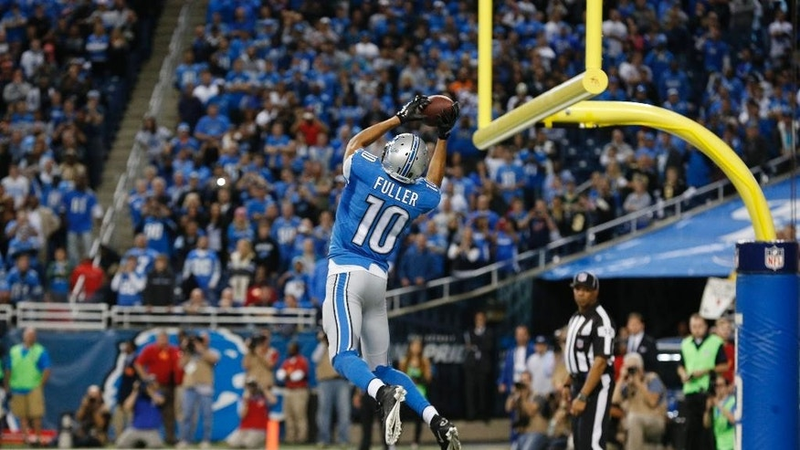 Detroit Lions wide receiver Corey Fuller (10) catches the game tying touchdown during the second half of an NFL football game against the New Orleans Saints in Detroit, Sunday, Oct. 19, 2014. (AP Photo/Paul Sancya)
