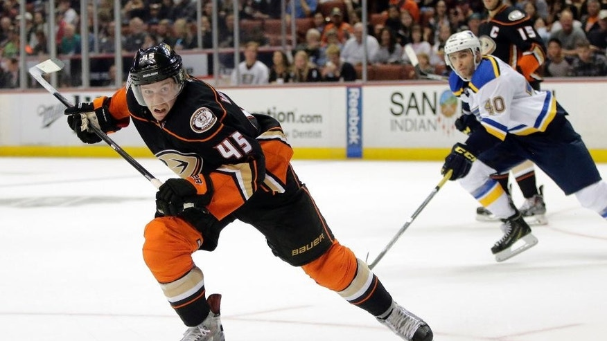 Anaheim Ducks' Sami Vatanen, left, of Finland, skates after the puck during the second period of an NHL hockey game against the St. Louis Blues, Sunday, Oct. 19, 2014, in Anaheim, Calif. (AP Photo/Jae C. Hong)