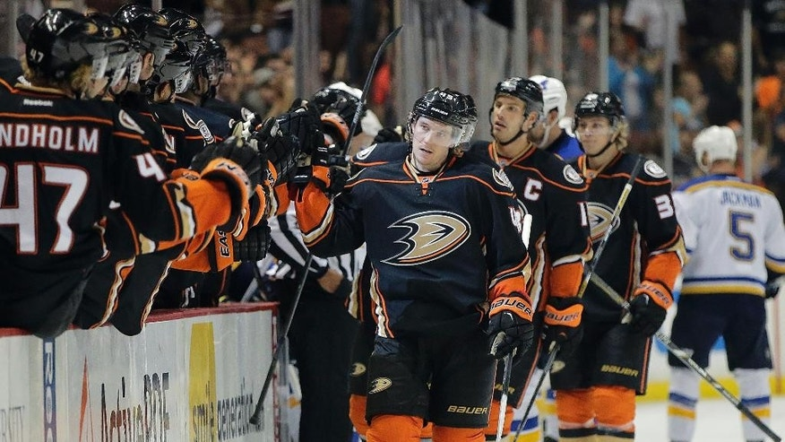 Anaheim Ducks' Sami Vatanen, center, of Finland, celebrates his goal during the first period of an NHL hockey game against the St. Louis Blues, Sunday, Oct. 19, 2014, in Anaheim, Calif. (AP Photo/Jae C. Hong)