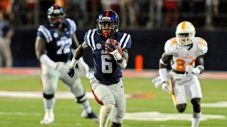 Mississippi running back Jaylen Walton (6) carries the ball during the second half of an NCAA college football game against Tennessee in Oxford, Miss., Saturday, Oct. 18, 2014. No. 3 Mississippi won 34-3. (AP Photo/The Daily Mississippian, Thomas Graning)
