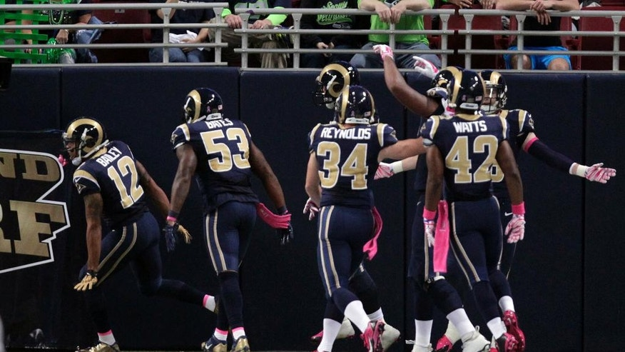 St. Louis Rams' Stedman Bailey, left, is congratulated by teammates after running a punt back 90 yards for a touchdown during the second quarter of an NFL football game against the Seattle Seahawks, Sunday, Oct. 19, 2014, in St. Louis. (AP Photo/Tom Gannam)