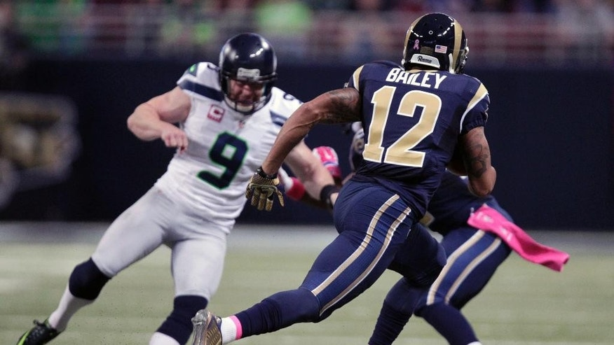 St. Louis Rams' Stedman Bailey, right, runs past Seattle Seahawks punter Jon Ryan, left, on his way to returning a punt 90 yards for a touchdown during the second quarter of an NFL football game Sunday, Oct. 19, 2014, in St. Louis. (AP Photo/Tom Gannam)
