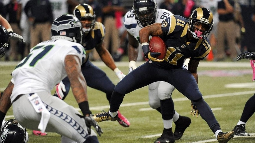 St. Louis Rams wide receiver Tavon Austin (11) runs for an 8-yard gain as Seattle Seahawks linebacker Mike Morgan, left, defends during the first quarter of an NFL football game Sunday, Oct. 19, 2014, in St. Louis. (AP Photo/L.G. Patterson)