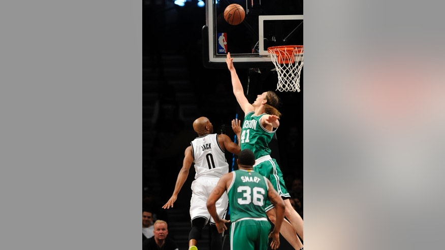 Boston Celtics center Kelly Olynyk (41) blocks the shot from Brooklyn Nets guard Jarrett Jack (0) as Boston Celtics guard Marcus Smart (36) looks on during the second half of a preseason NBA basketball game on Sunday, Oct. 19, 2014 at Barclays Center in New York. The Celtics won 95-90. (AP Photo/Kathy Kmonicek)