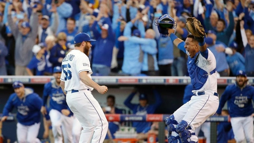 Kansas City Royals relief pitcher Greg Holland and catcher Salvador Perez celebrate after the Royals defeated the Baltimore Orioles 2-1 in Game 4 of the American League baseball championship series Wednesday, Oct. 15, 2014, in Kansas City, Mo. The Royals advance to the World Series. (AP Photo/Matt Slocum )