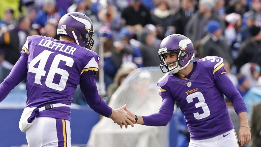 Minnesota Vikings kicker Blair Walsh (3) celebrates with teammate Cullen Loeffler (46) after kicking a field goal during the first half of an NFL football game against the Buffalo Bills, Sunday, Oct. 19, 2014, in Orchard Park, N.Y.  (AP Photo/Bill Wippert)