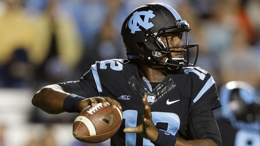 North Carolina quarterback Marquise Williams looks to pass the ball during the first half of an NCAA college football game against Georgia Tech in Chapel Hill, N.C., Saturday, Oct. 18, 2014. (AP Photo/Gerry Broome)
