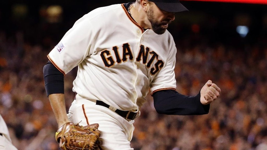 San Francisco Giants' Jeremy Affeldt reacts after getting St. Louis Cardinals' Oscar Taveras to ground out and end the top of the ninth inning of Game 5 of the National League baseball championship series Thursday, Oct. 16, 2014, in San Francisco. (AP Photo/David J. Phillip)