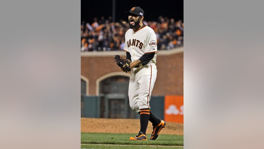 San Francisco Giants relief pitcher Sergio Romo celebrates the end of the top of the eighth inning of Game 4 of the National League baseball championship series against the St. Louis Cardinals Wednesday, Oct. 15, 2014, in San Francisco. (AP Photo/Jeff Roberson)