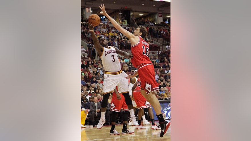 Cleveland Cavaliers' Dion Waiters, left, shoots over Chicago Bulls' Pau Gasol, of Spain, during the first quarter of an NBA preseason basketball game Monday, Oct. 20, 2014, in Columbus, Ohio. (AP Photo/Jay LaPrete)
