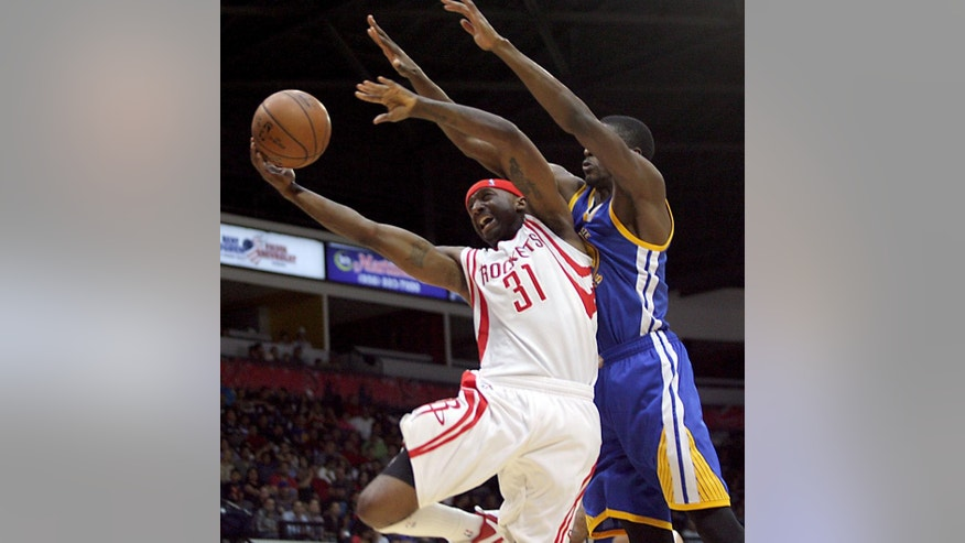Houston Rockets Jason Terry, left, is fouled by a Golden State Warriors defender during an NBA preseason basketball game in Hidalgo, Texas, Sunday, Oct. 19, 2014. (AP Photo/Delcia Lopez)