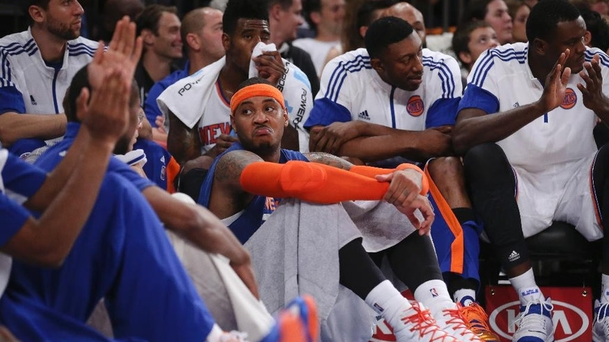 New York Knicks forward Carmelo Anthony, center, reacts alongside his teammates in the final minutes of the second half of their preseason NBA basketball game against the Milwaukee Bucks at Madison Square Garden, Monday, Oct. 20, 2014, in New York. The Bucks won, 120-107. (AP Photo/John Minchillo)