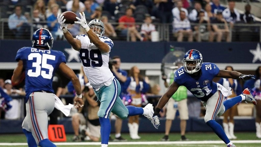 New York Giants' Quintin Demps (35) and Zack Bowman (31) defend as Dallas Cowboys tight end Gavin Escobar (89) comes down with a reception for a touchdown during the second half of an NFL football game Sunday, Oct. 19, 2014, in Arlington, Texas. (AP Photo/Brandon Wade)