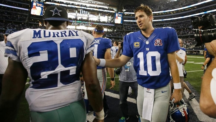 Dallas Cowboys' DeMarco Murray (29) is congratulated by New York Giants' Eli Manning (10) after their NFL football game, Sunday, Oct.  19, 2014, in Arlington, Texas. The Cowboys won 31-21. (AP Photo/Brandon Wade)