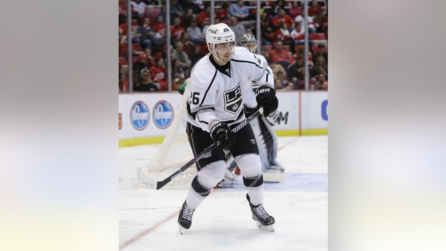 FILE - In this Jan. 18, 2014, file photo, Los Angeles Kings defenseman Slava Voynov (26), of Russia, is seen during the second period of an NHL hockey game against the Detroit Red Wings in Detroit. The NHL has indefinitely suspended Voynov because of domestic violence charges. The league says he was arrested Monday morning, Oct. 20, 2014,  but isn't providing other details. Police in the Los Angeles suburb of Redondo Beach released limited information early Monday, giving no details of what is alleged to have occurred.  (AP Photo/Carlos Osorio, File)
