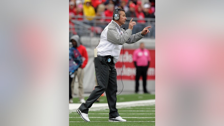 Ohio State head coach Urban Meyer instructs his team against Rutgers during the second quarter of an NCAA college football game Saturday, Oct. 18, 2014, in Columbus, Ohio. Ohio State won 56-17. (AP Photo/Jay LaPrete)