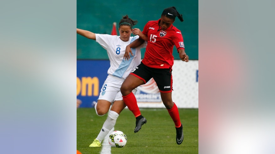 Guatemala forward Maria Monterroso (8) and Trinidad & Tobago defender Liana Hinds (15) go for the ball during the first half of a CONCACAF soccer match, at RFK Stadium, Monday, Oct. 20, 2014, in Washington. (AP Photo/Alex Brandon)
