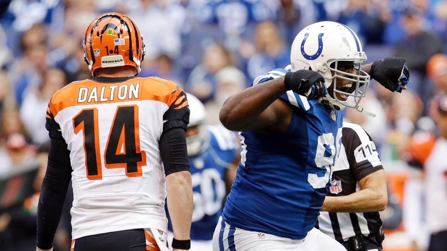 Indianapolis Colts defensive end Cory Redding, right, celebrates after sacking Cincinnati Bengals quarterback Andy Dalton (14) during the first half of an NFL football game Sunday, Oct. 19, 2014, in Indianapolis. (AP Photo/AJ Mast)