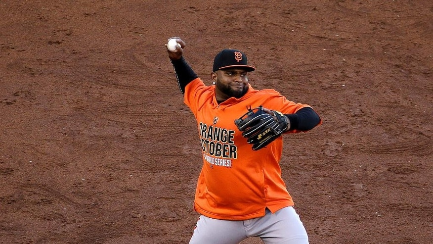 San Francisco Giants' Pablo Sandoval throws during baseball practice Monday, Oct. 20, 2014, in Kansas City, Mo. The Kansas City Royals will host the Giants in Game 1 of the World Series on Oct. 21. (AP Photo/Charlie Riedel)