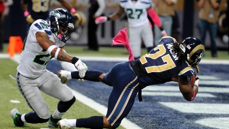 t. Louis Rams running back Tre Mason, right, slips past Seattle Seahawks free safety Earl Thomas on his way to a 6-yard touchdown run during the first quarter of an NFL football game Sunday, Oct. 19, 2014, in St. Louis. (AP Photo/L.G. Patterson)