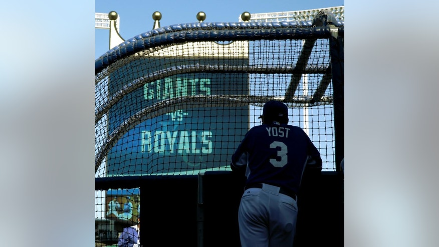 Kansas City Royals manager Ned Yost watches batters during baseball practice Monday, Oct. 20, 2014, in Kansas City, Mo. The Royals will host the San Francisco Giants in Game 1 of the World Series on Oct. 21. (AP Photo/Charlie Riedel)