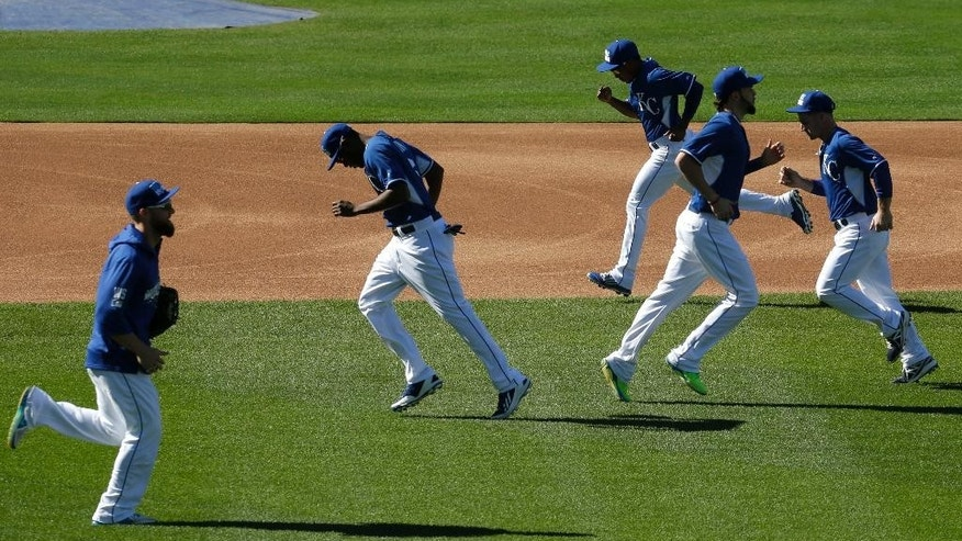 Players for the Kansas City Royals run during baseball practice Monday, Oct. 20, 2014, in Kansas City, Mo. The Royals will host the San Francisco Giants in Game 1 of the World Series on Oct. 21. (AP Photo/Charlie Riedel)