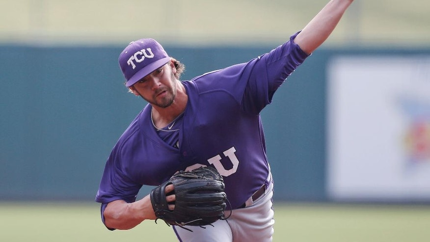FILE - In this May 24, 2014, file photo, TCU's Brandon Finnegan pitches in the first inning of a game against Baylor in the Big 12 conference NCAA college baseball tournament in Oklahoma City. Finnegan helped pitch TCU into the College World Series this spring, and that was pretty special. Now he's about to top that, poised to cap a rapid rise as a reliever for the Kansas City Royals in the World Series.(AP Photo/Sue Ogrocki, File)