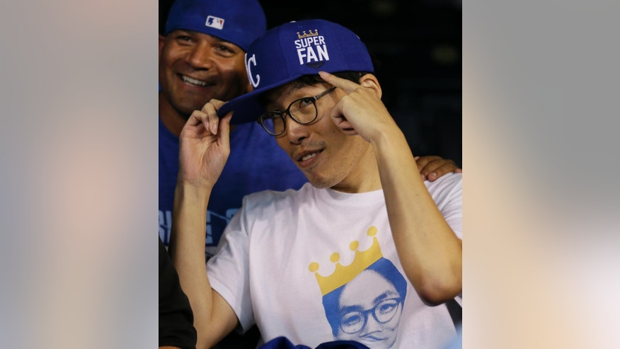"Kansas City Royals fan Sung Woo Lee, from South Korea, shows off his ""super fan' cap before Game 1 of baseball's World Series between the Kansas City Royals and the San Francisco Giants Tuesday, Oct. 21, 2014, in Kansas City, Mo. (AP Photo/Charlie Neibergall)"