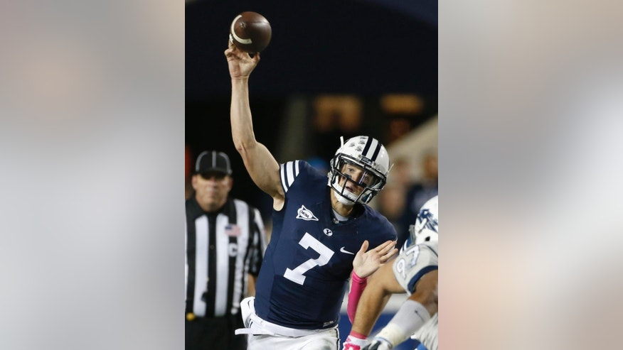 BYU quarterback Christian Stewart passes the ball against Nevada during the first half of an NCAA college football game in Provo, Utah, Saturday, Oct. 18, 2014. (AP Photo/George Frey)