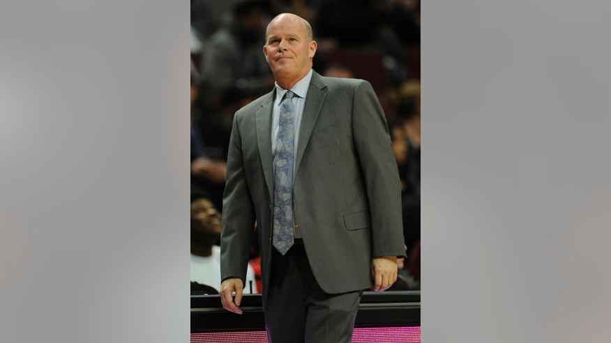 Charlotte Hornets head coach Steve Clifford looks on during the second half of a preseason NBA basketball game against the Chicago Bulls in Chicago, Sunday, Oct. 19, 2014. Chicago won 101-96. (AP Photo/Paul Beaty)