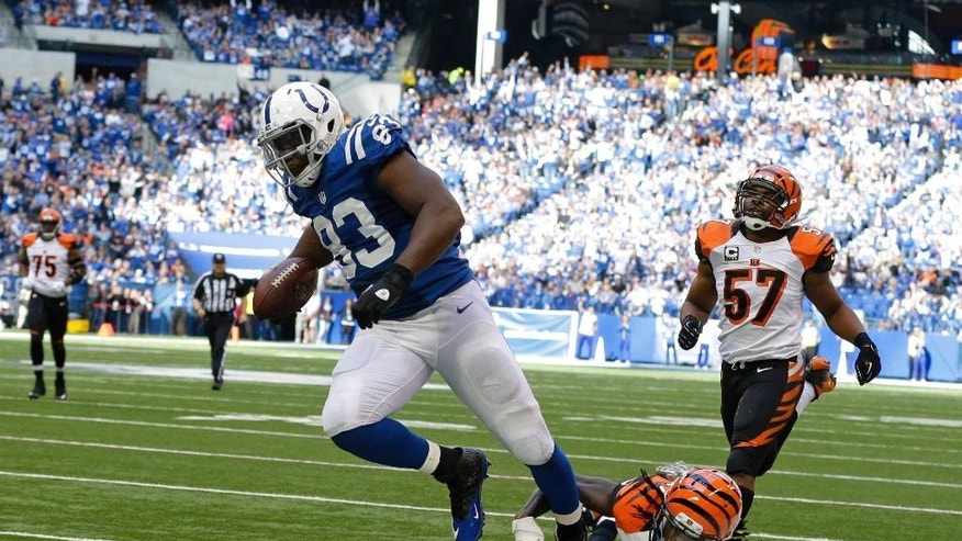 Indianapolis Colts tight end Dwayne Allen (83) makes a 32-yard touchdown reception against Cincinnati Bengals cornerback Dre Kirkpatrick (27) during the second half of an NFL football game Sunday, Oct. 19, 2014, in Indianapolis. (AP Photo/Michael Conroy)