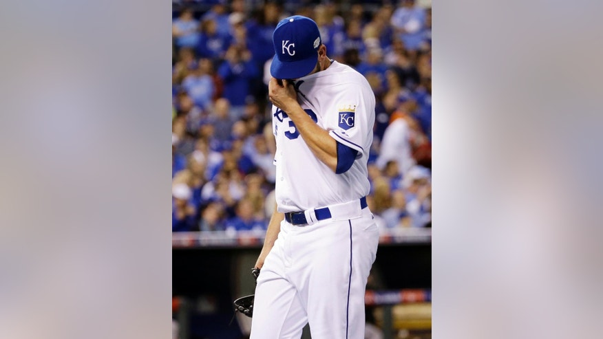 Kansas City Royals pitcher James Shields wipes his face as he is taken out of the game during the fourth inning of Game 1 of baseball's World Series against the San Francisco Giants Tuesday, Oct. 21, 2014, in Kansas City, Mo. (AP Photo/David J. Phillip)
