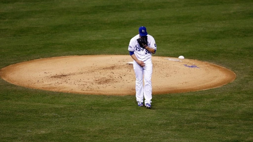 Kansas City Royals pitcher James Shields walks off the mound after giving up three runs in the first inning of Game 1 of baseball's World Series against the San Francisco Giants Tuesday, Oct. 21, 2014, in Kansas City, Mo. (AP Photo/Jeff Roberson)