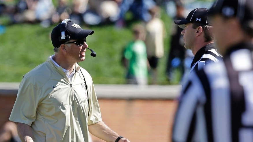 Wake Forest head coach Dave Clawson, left, argues a call with officials during the second half of an NCAA college football game against Syracuse in Winston-Salem, N.C., Saturday, Oct. 18, 2014. Syracuse won 30-7. (AP Photo/Chuck Burton)