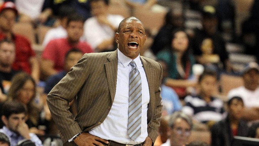 Los Angeles Clippers head coach Doc Rivers instructs his team during the second half of an NBA preseason basketball game on Saturday, Oct. 18, 2014, in Las Vegas. The Nuggets defeated the Clippers 104-93. (AP Photo/Isaac Brekken)