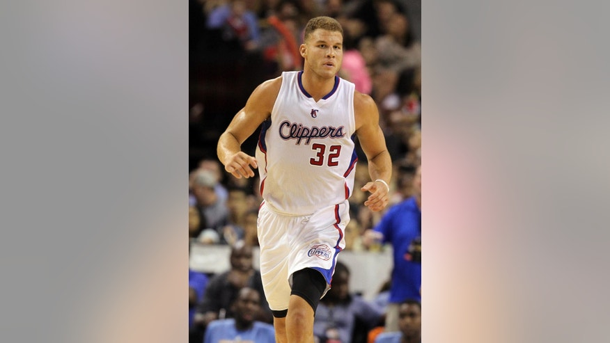 Los Angeles Clippers forward Blake Griffin (32) runs down the court during the second half of an NBA preseason basketball game against the Denver Nuggets on Saturday, Oct. 18, 2014, in Las Vegas. The Nuggets defeated the Clippers 104-93. (AP Photo/Isaac Brekken)