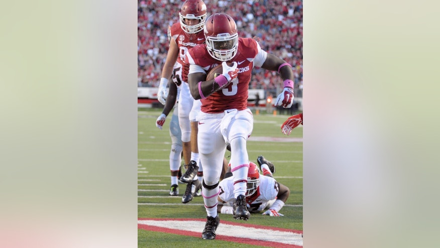 Arkansas running back Alex Collins (3) scores a six-yard rushing touchdown in the fourth quarter of an NCAA college football game in Little Rock, Ark., Saturday, Oct. 18, 2014. Georgia defeated arkansas 45-32. (AP Photo/David Quinn)
